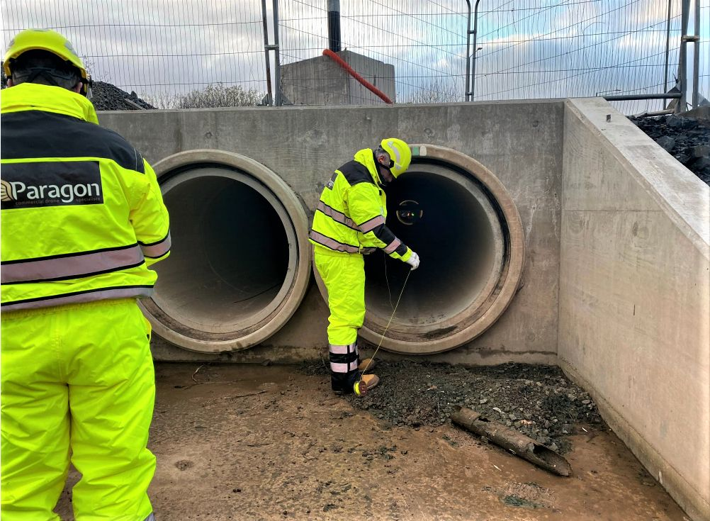 Flyability Elios 2 drone inspecting a culvert. Drones impacting businesses.